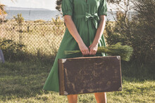 Woman In Green Dress Holding A...