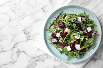 Fresh delicious beet salad on white marble table, top view. Space for text