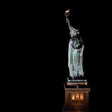 USA, New York, New York City, Statue Of Liberty Illuminated At Night