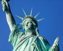 USA, New York, New York City, Statue Of Liberty Against Blue Sky