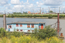 Germany, Hamburg, Spreehafen, Houseboat On River With Dock In Distance