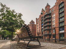 Germany, Hamburg, Speicherstadt, Old, Brick Industrial Buildings With Bench In Foreground