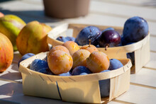 Baskets Of Fresh Ripe Plums