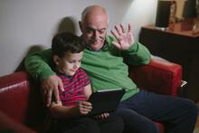 Granpa And Grandkid Making A Video Call