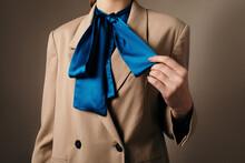 Crop Woman Adjusting Trendy Tie