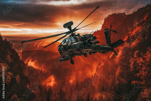 Fototapeta American attack helicopter flies over a beautiful landscape