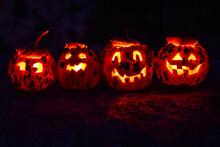 Row Of Four Carved Bumpy Pumpk...