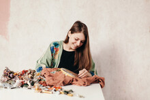 Happy Woman Embroidering Color...