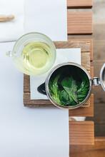 Fresh Mint Tea In Teapot And G...