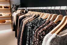 Rack With Trendy Clothes In St...