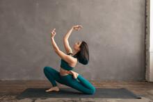 Focused Female Doing Yoga Exer...