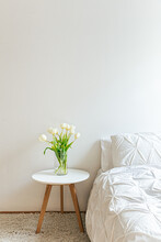 White Bedroom With Tulips On S...