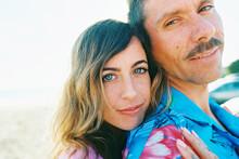 Hip Couple On Beach With Daisi...