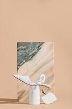 Stylish Shoe Against Marble Block