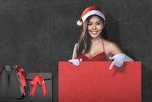 Asian Woman In Santa Costume H...