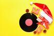 Leinwandbild Motiv Vinyl disk and Christmas decor on color background