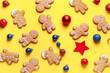 Leinwandbild Motiv Tasty gingerbread cookies and Christmas decor on color background