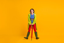 Full Length Photo Portrait Of Funky Laughing Girl Leaning On Umbrella Isolated On Bright Yellow Colored Background