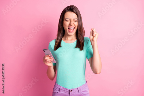 Canvas Print Photo portrait of cheerful girl celebrating holding phone in one hand with open