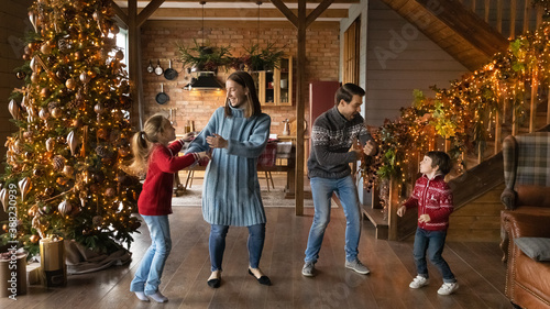 Fotografering Wide banner panoramic view of happy young Caucasian family with two small kids have fun celebrating Christmas at home