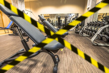 Concept Of Gyms Closure For Covid-19 Pandemic. Coronavirus Covid 19 Quarantine Lockdown Of Sport Activities Indoor. Concept Of Health And Wellness In Epidemic Time.