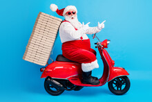 Full Length Profile Side Photo Of Crazy White Grey Hair Bearded Santa Claus Drive X-mas Christmas Scooter Deliver Pizza Stack Point Finger Way Wear Red Costume Isolated Blue Color Background