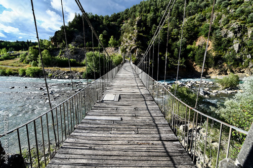wooden bridge in forest, photo as a background , in janovas fiscal sobrarbe , huesca aragon province