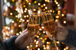 canvas print picture - Crop close up of man and woman hold glasses with champagne clink greet congratulate with New Year. Couple celebrate Christmas winter holidays at home together, wish luck and joy. Celebration concept.