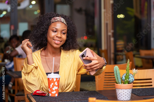 Fototapety, obrazy: image of beautiful african lady, with smart phone, food and drink concept