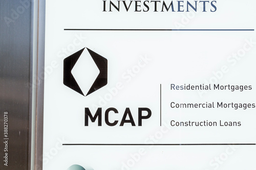 Naklejka premium Toronto, Canada - May 16, 2020: MCAP company sign is seen outside their headquarters in downtown Toronto, Canada. MCAP is a Canadian mortgage and development finance company.