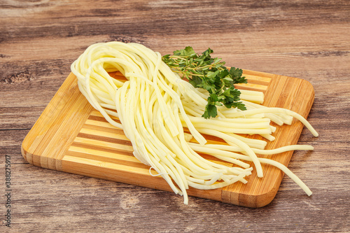 Chechil spaghetti cheese over board Fototapet
