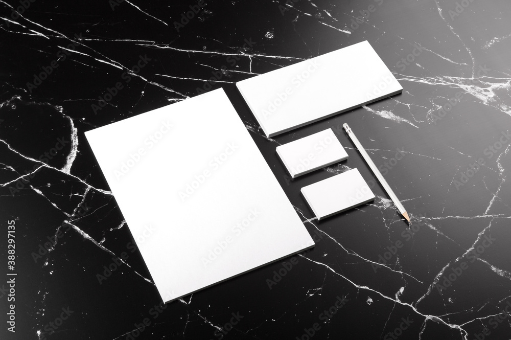 Fototapeta Photo of branding identity mock up on marble. Template isolated on marble background. For graphic designers presentations and portfolios marble premium luxury mock-up