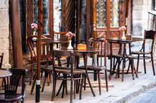 Wooden Tables And Chairs In A ...