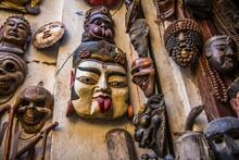 Wooden Sacral Masks Sold At Street Market In Kathmandu, Nepal.