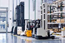 New Self Propelled Lifting Platforms In A White Warehouse Of A Factory.