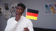 Leinwandbild Motiv Young black man with german flag. Student exchange program or work relocation concept. High quality photo