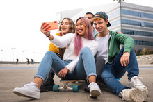 Happy Group Of Friends Takes A Selfie Outdoor.