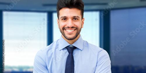 Obraz Portrait of a handsome businessman in a modern office - fototapety do salonu