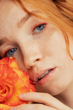Fashion Photo Woman Extended Colored Fake Eyelashes For Red Haired With Rose Flower Face