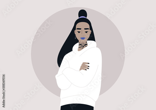 Canvas Print A portrait of a young Asian girl with tattoos and piercing wearing a hoodie and