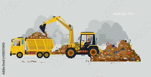 Obraz The workers drive the excavator to collect the garbage into the truck.  - fototapety do salonu
