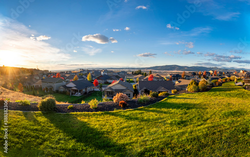 Photo View of the city of Spokane Valley from a hilltop home in a subdivision during autumn