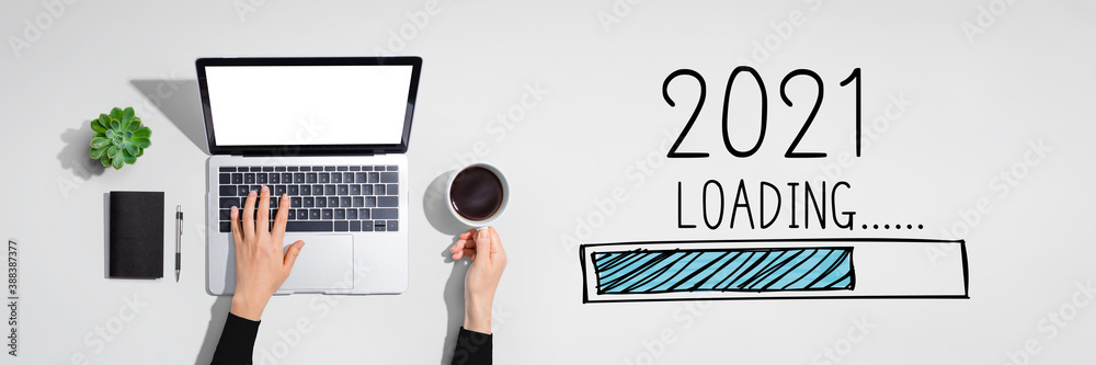 Fototapeta Loading new year 2021 with person using a laptop computer