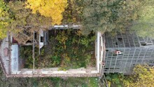 Aerial Drone View Of Abandoned, Destroyed Building Surrounded By Colorful Autumn Trees And Plants, Top View