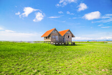 Twin Old House On Wetland At Talay Noi Lake At Phatthalung, Thailand.