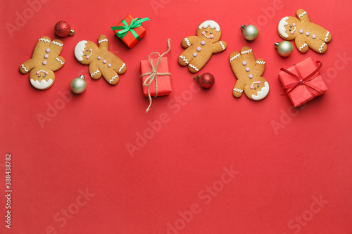 Fototapeta Tasty gingerbread cookies and Christmas decor on color background obraz
