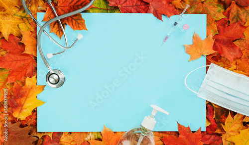Fotografie, Obraz Flu and cold season frame on blue with fall leaves