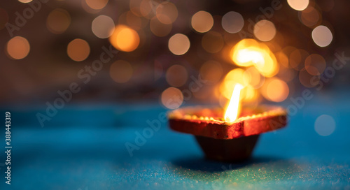 Fotografie, Obraz Beautiful clay diya lamps lit during diwali celebration, selective focus