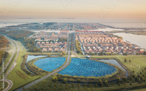 Obraz Sustainable neighbourhood in Netherlands powered by solar panels, aerial view - fototapety do salonu
