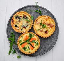 Tartlets With Mushrooms, Salmon And Chicken On A Wooden Background.